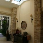 Entry with ridge beam-less ridge skylight.