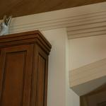 Detail of custom cabinets with trim matching cornice design.