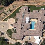 Aerial view shows courtyard with pool in center.