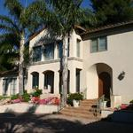 Formal Spanish Colonial of 4,500 sq. ft. on upslope lot designed in the late 90's.